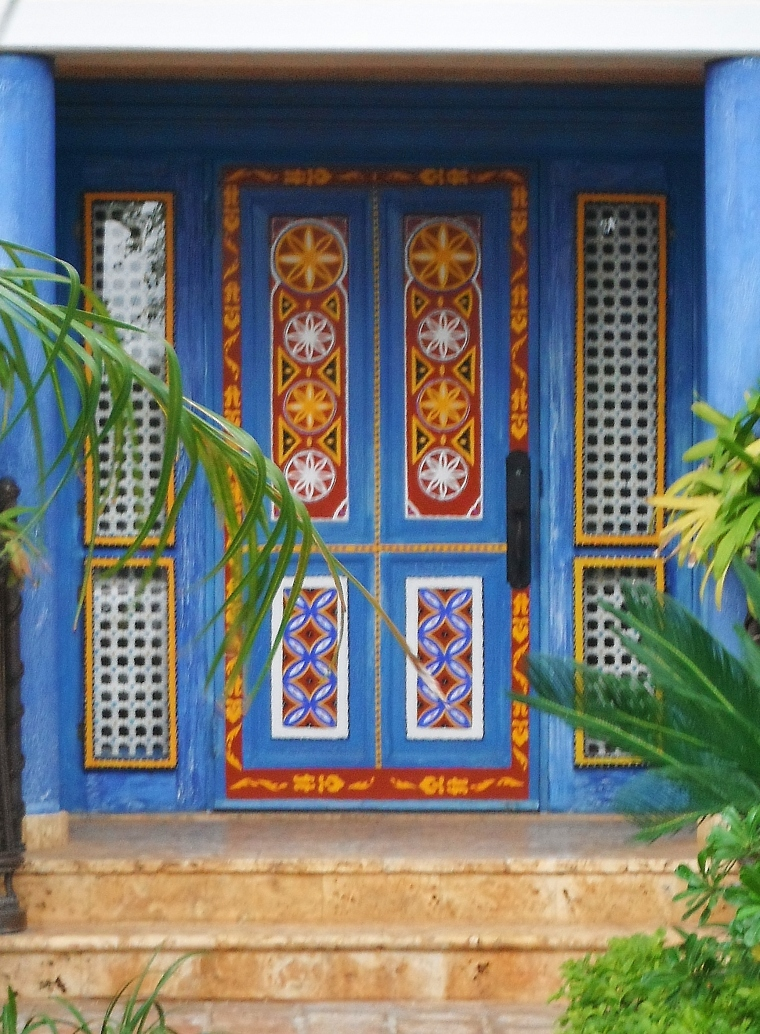 A beautiful painted door leads to a villa at the marina in Casa de Campo