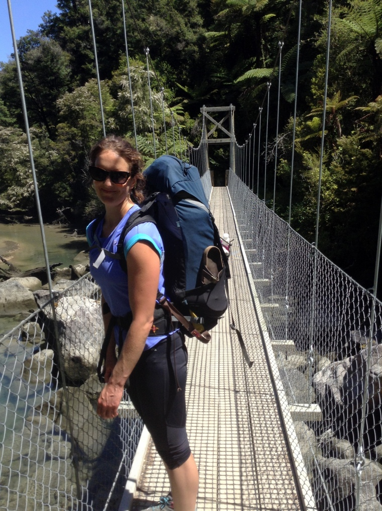 Sarah strikes a suspension bridge pose
